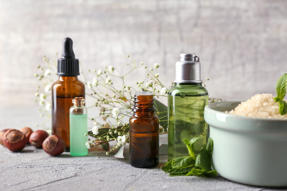 natural remedy bottles and plants